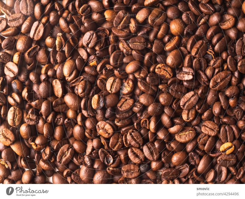 Aromatic roasted coffe beans for background brown coffee black caffeine drink espresso natural white breakfast coffee beans dark table cafe closeup cup morning