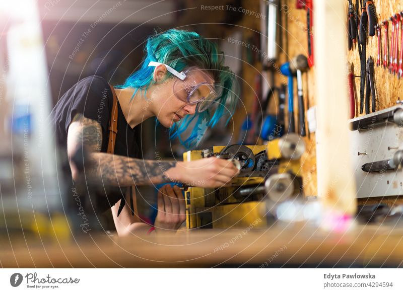Mechanic Woman at Work sales clerk bicycle bicycle mechanic bicycling bike shop business retail helpful indoors woman female manager owner profession repair