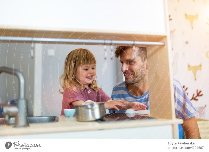 Father Playing with Daughter At Home home house man dad father family parent relatives child daughter girl little girl kid kids children relationship together