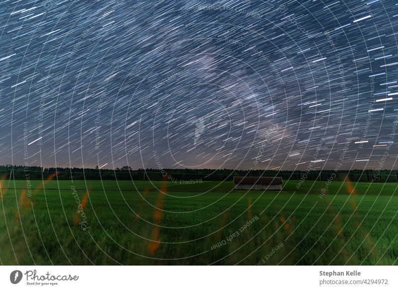Startrails over a little hut at a farmland at the starry night, beautiful nature and concept for motion of the earth. startrails house sky dark light long space