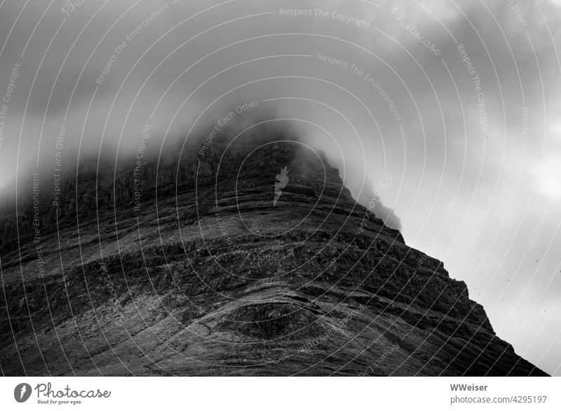 The top of the mountain is shrouded by a cloud, its eye looks at you Steep slope Eyes Weather Fog Sky Peak Above height Rock Mountain Clouds Landscape Nature