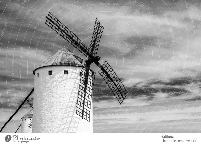 Traditional Spanish windmill in Campo de Criptana, Castilla La Mancha, Spain, on the famous Don Quixote Route; black and white image Cervantes Ciudad Real