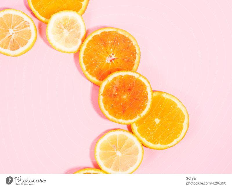 Colorful orange citrus slice fruit texture background on pastel pink fresh yellow white pastel color food pattern cut flatlay vitamin flat lay sweet organic