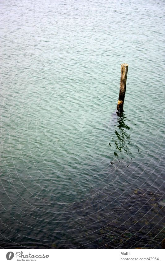 lonely at sea Ocean Green Waves Reflection Blue Pole Water Joist Harbour
