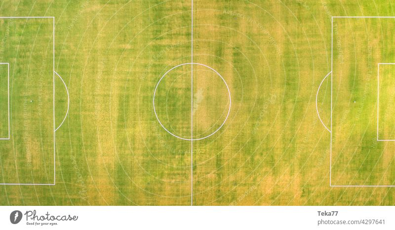 a small football field from above panorama sports football field top down green grass sun lines football field in summer