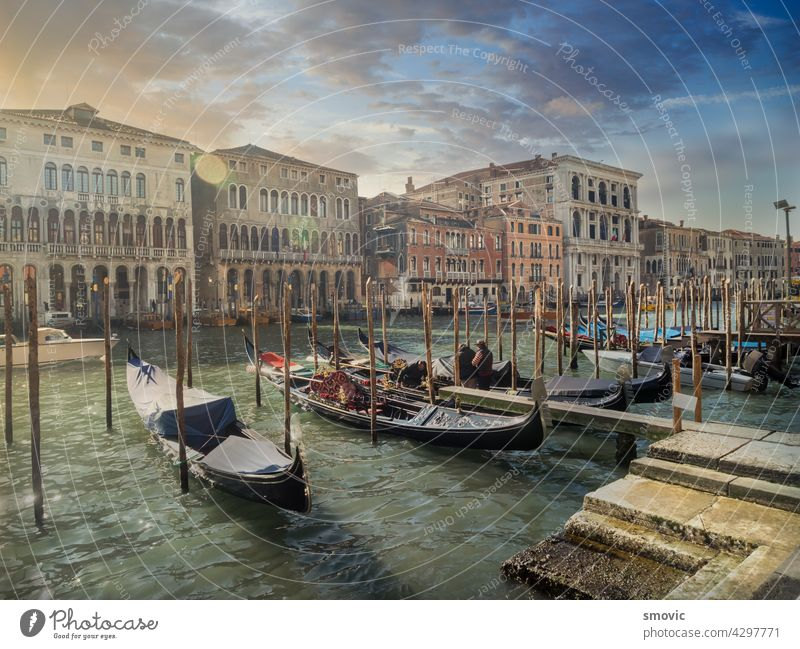 Beautiful sunrise in Venice, views of one of its famous canals crisscrossed by gondolas. venice italy travel architecture venetian italian city water europe