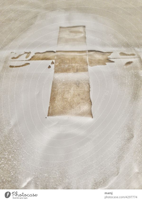 Cross. Here once a tape has covered something cross-shaped. Crucifix cruciform Symbols and metaphors Christian cross Religion and faith Christianity