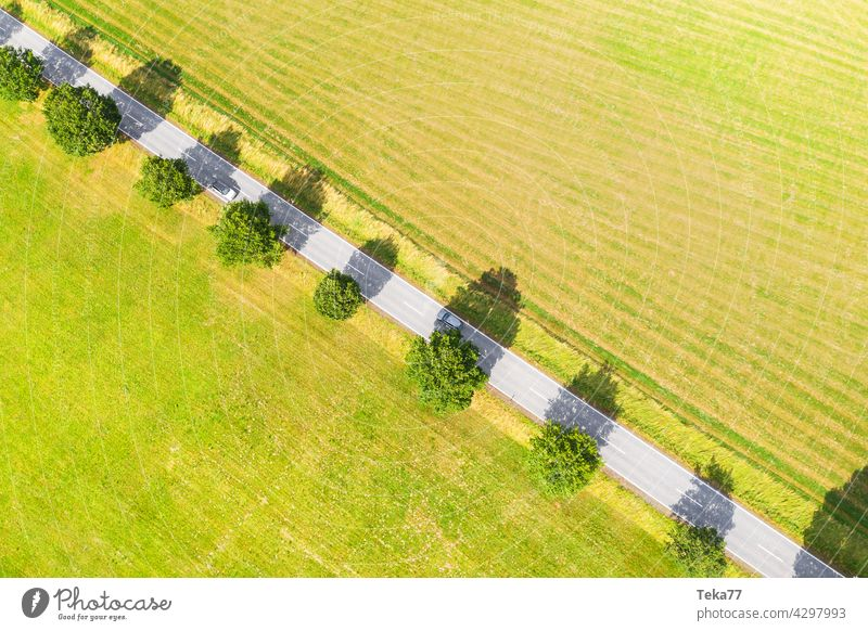 The highway Country road Street Road traffic Agriculture country Summer aerial photograph acre Meadow