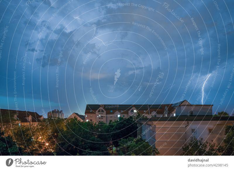 Thunderstorm over the city Mannheim. thunderstorm lightning strike impact electricity hazard danger cloud wind twilight landscape cityscape skyline building