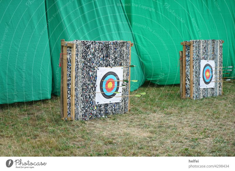 Target shot with colored arrows, bow and arrow sport Arrow Strike Leisure and hobbies Darts Sports Accuracy Dartboard Shoot Aim Precision Success Sporting event