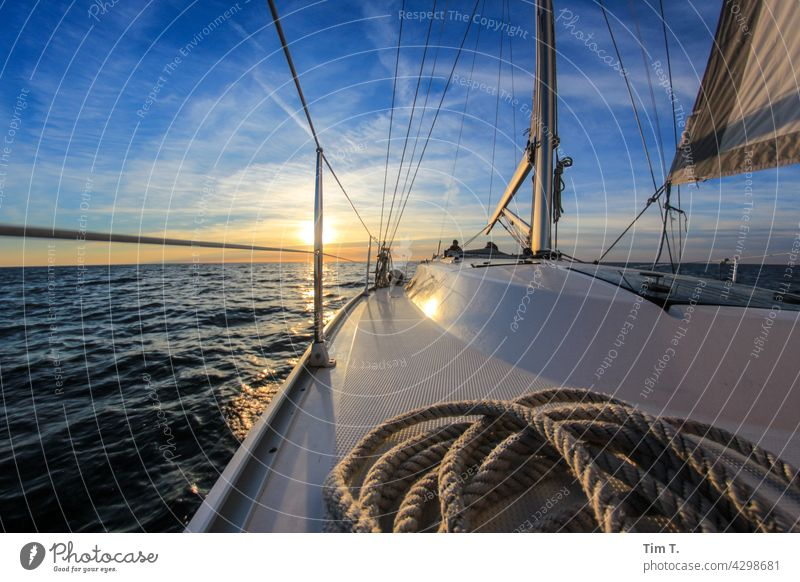 View over a ship deck into the sunset Sailing ship Water Ocean Sailboat Vacation & Travel Navigation Exterior shot Colour photo Boating trip Summer Freedom