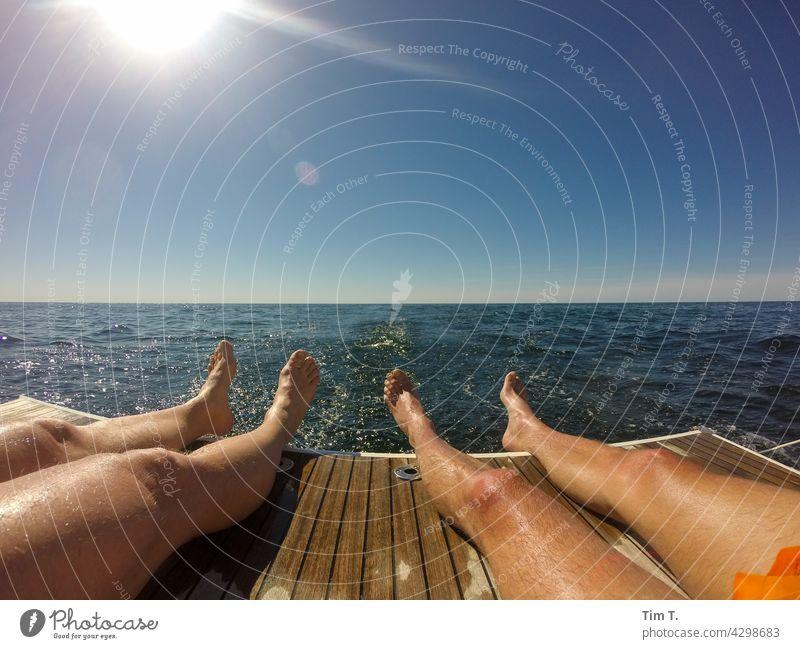 Four legs on a bathing flap four Legs Baltic Sea Sailing bathe Colour photo Swimming & Bathing Vacation & Travel Waves Water Ocean Summer Exterior shot Joy Sun