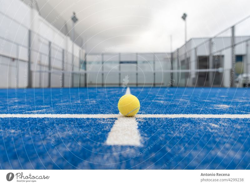wide angle image of blue paddle tennis court without people padel sport ball racket net outdoors recreation turf grass equipment game leisure sports balls line