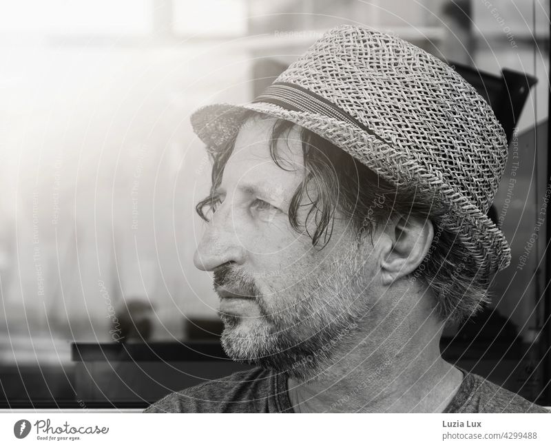 Man with straw hat looks into the distance, is on a journey portrait Summer sunshine Straw hat voyage travel ship Vacation & Travel Exterior shot Sunlight