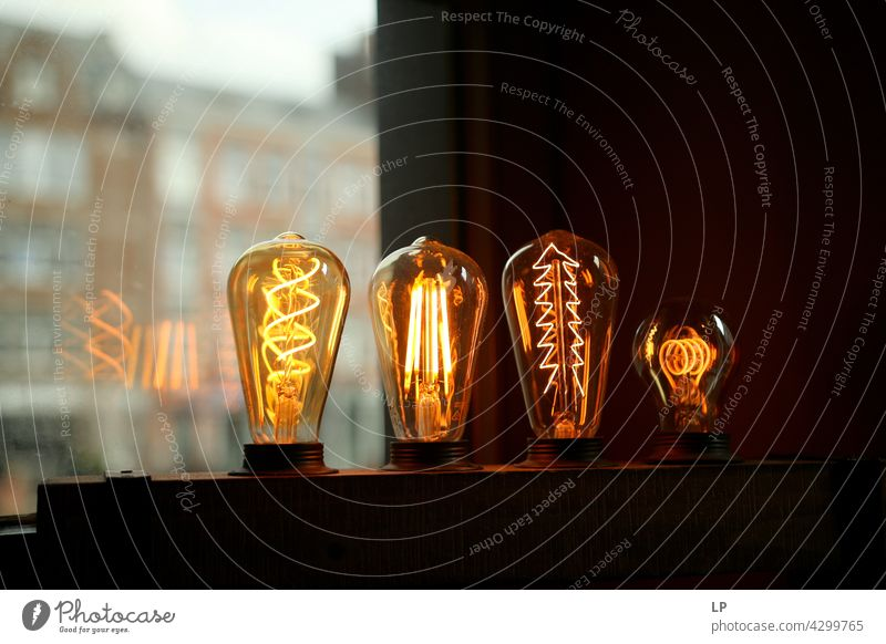 lightbulbs on a contrasted background watts Vertical Symbols and metaphors Supply Socket shape power point Object photography Lamp holder innovation image