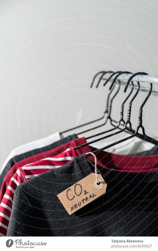 Clothes with carbon emission label clothes hanger rail neutral store retail shop rack second hand casual purchase textile wear fabric choice shopping cotton