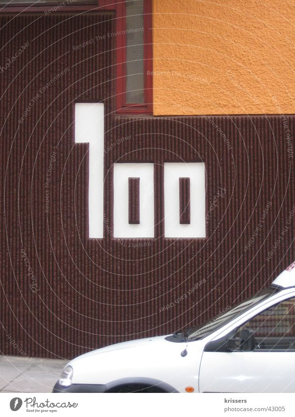 one hundred 100 House number Wall (building) House (Residential Structure) Brown Retro Stuttgart Architecture Digits and numbers Car Orange dogret white