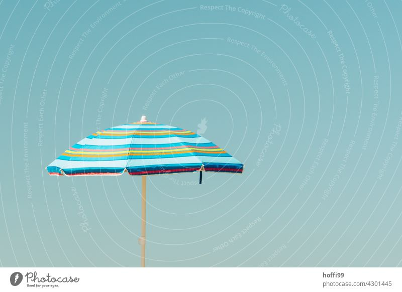 blue striped parasol in front of blue sky Sunshade Blue sky Striped shade dispenser Sunlight Vacation & Travel Beach Shadow Summer vacation Relaxation