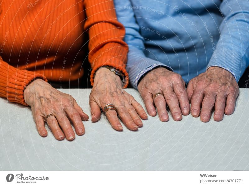 Two pairs of old hands that belong together as the wedding rings prove Couple Matrimony Married couple Old man and woman married couple Wedding rings older