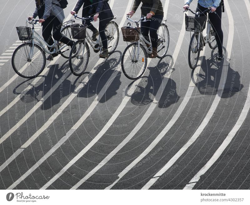 Four female cyclists cross the Superkilen facility in Copenhagen structure Structures and shapes asphalting Progress Lined Landmark on track streamline shape