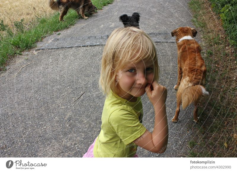 mischievous look of child with dogs in background Child Dog Impish cheerful Pet Watchdog Love of animals off walk Walk the dog Outdoors Infancy Looking