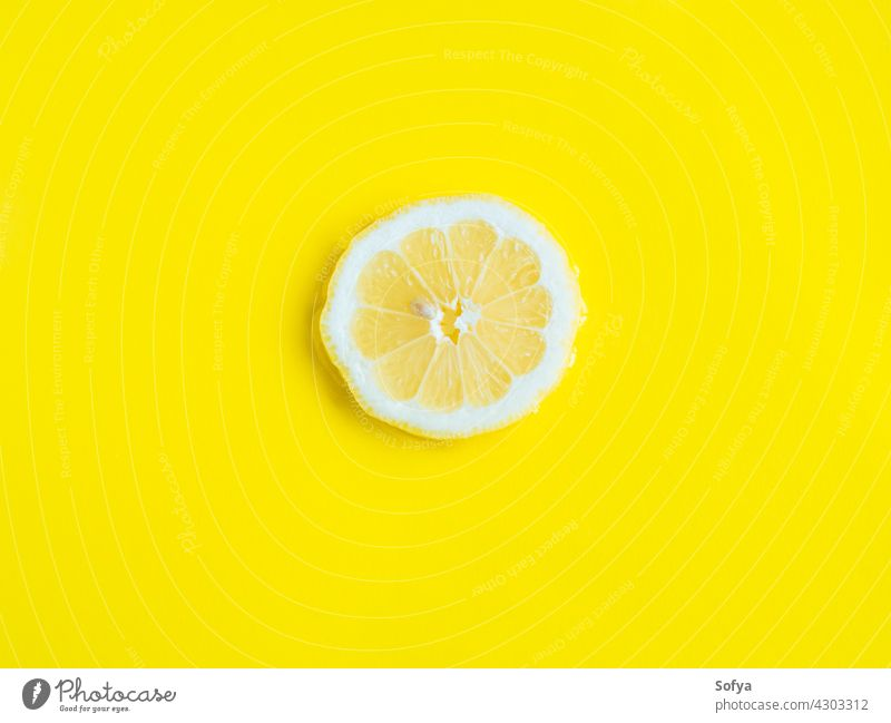 Intense yellow lemon citrus slice in water, texture summer background fresh fruit food vitamin color pattern cut flatlay flat lay liquid healthy juicy lemonade