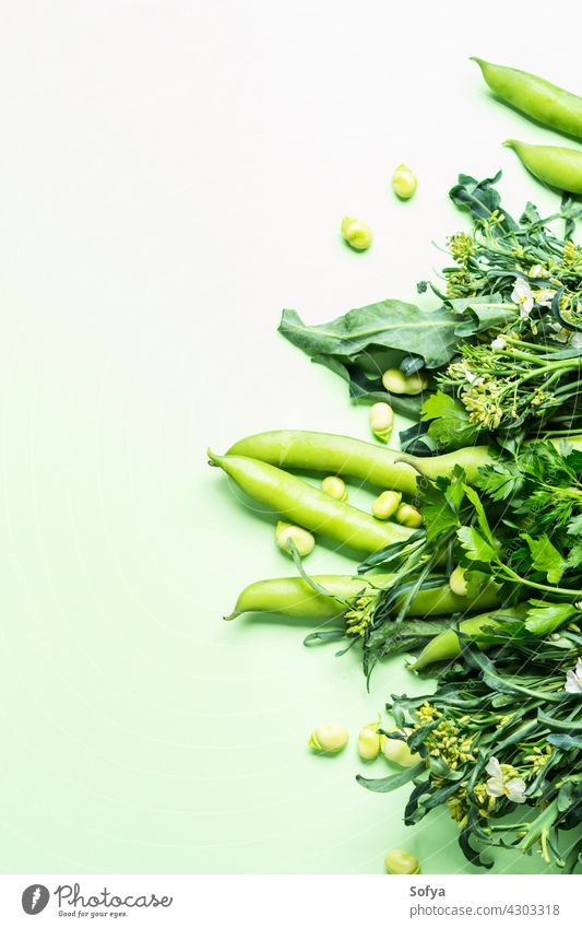 Green vegetables and herbs on pastel background market vegan grocery delivery produce monochrome beans broccoli agriculture clean diet eating food fresh green