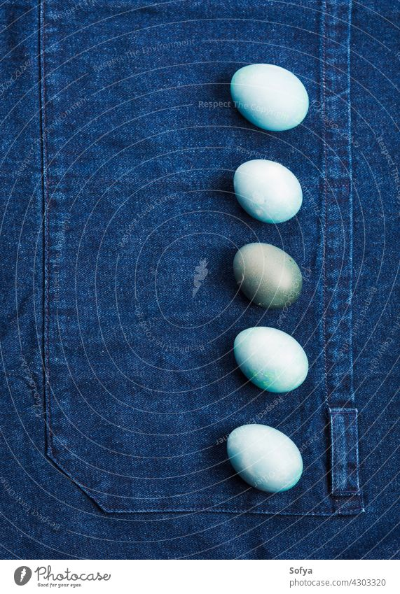 Easter boiled colorful eggs on jeans background easter blue holiday spring design food hen hard flat lay table copy space celebrate festive texture hunt minimal