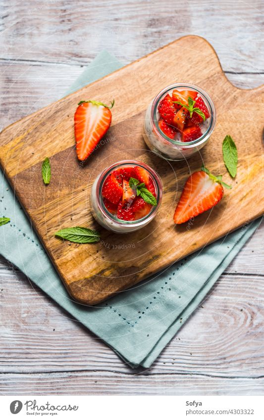 Yogurt and granola with strawberries. Breakfast strawberry breakfast dessert yogurt food fruit glass healthy sweet gourmet morning pudding vegan cereal