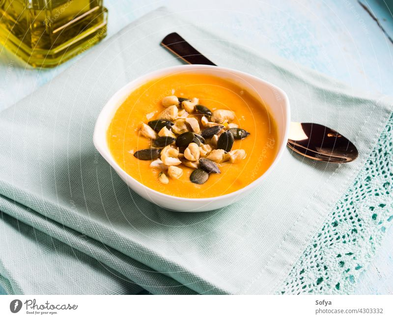 Bean squash creamy soup served with seeds and nuts pumpkin vegetable autumn bean bowl cannellini puree cashew chickpea cuisine delicious dinner carrot fall food