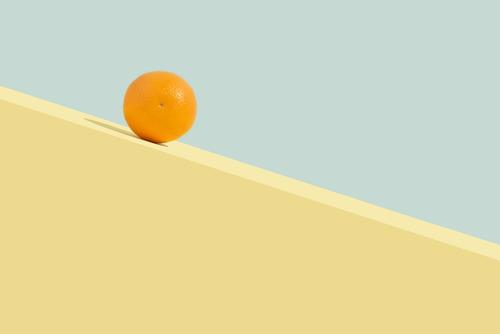 Summer orange fruit rolling downhill. Abstract concept Contemporary Rectangle Aesthetics Art background Blue Citrus fruits Colour colourful Copy Space