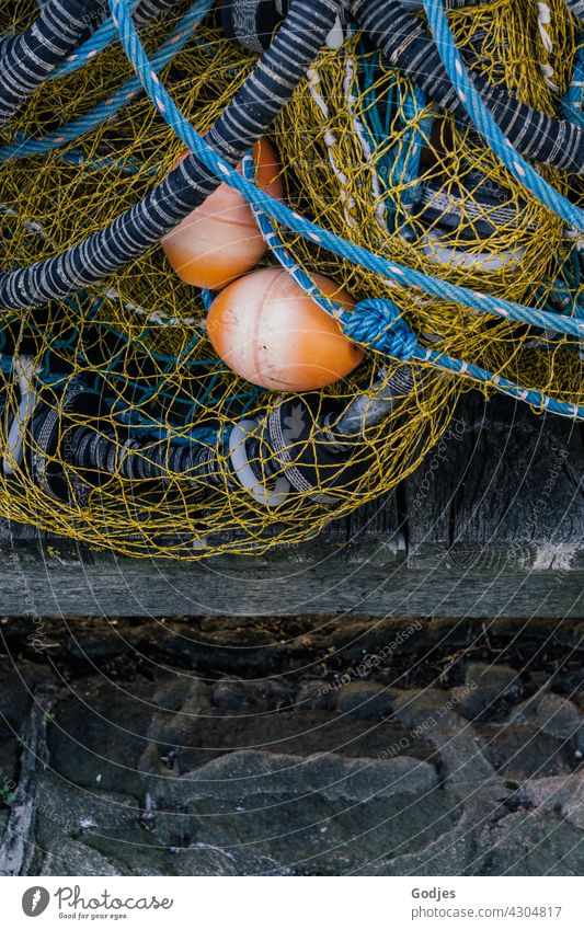 Fishing net lies on a jetty fishing Fishery Net Colour photo Exterior shot Network Day Fishing (Angle) Catch Harbour Fishing port Reticular buoys Orange Blue