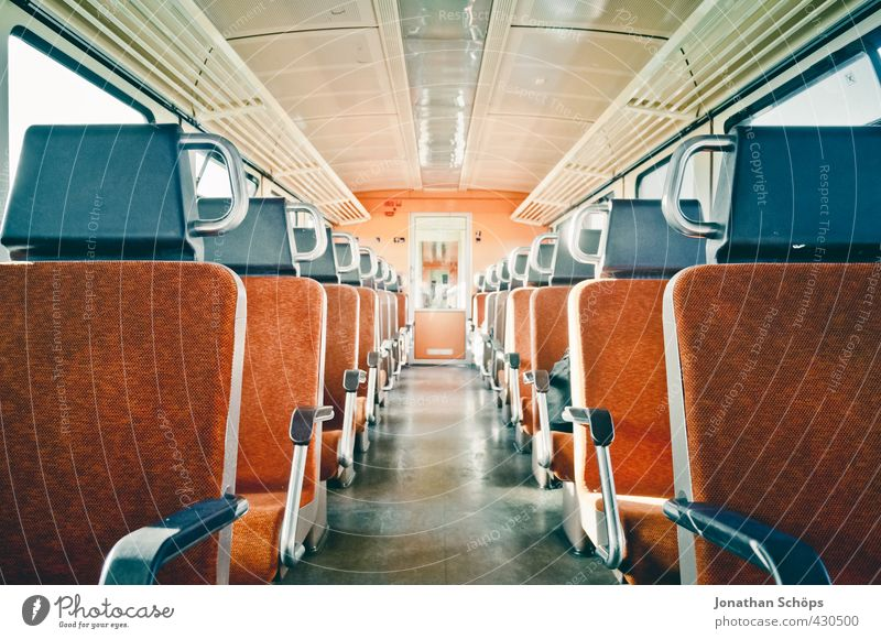 Middle aisle in an empty compartment on the train in the train Transport Means of transport Train travel Rail transport Passenger train Train compartment Modern