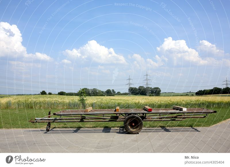 Hay trailer Agricultural machine Agriculture Trailer Agricultural trailer Tractor trailer Blue sky Landscape Hayride Farm Nature Rural Vehicle Transport Field