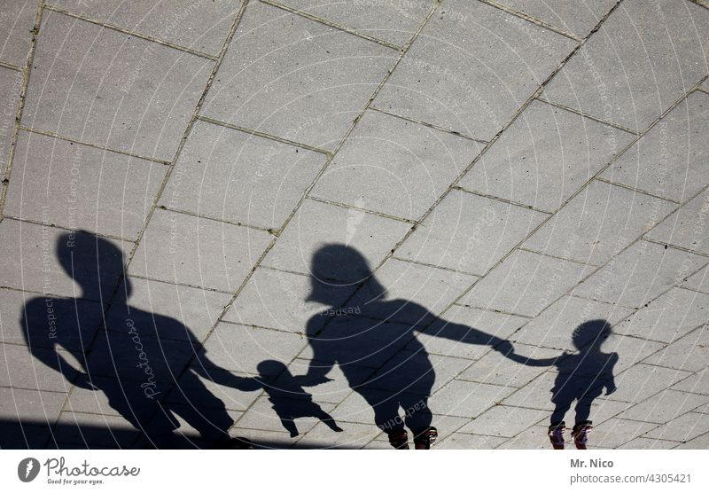 family happiness Family & Relations Shadow Related Trust Shadow play Together Family outing Domestic happiness Attachment Group Happy Father Mother Woman Adults