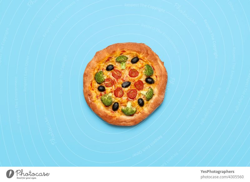 Vegan pizza isolated on blue table. Homemade vegetable pizza, top view Italian above alternative background bake broccoli cashew cheese color cooking copy space
