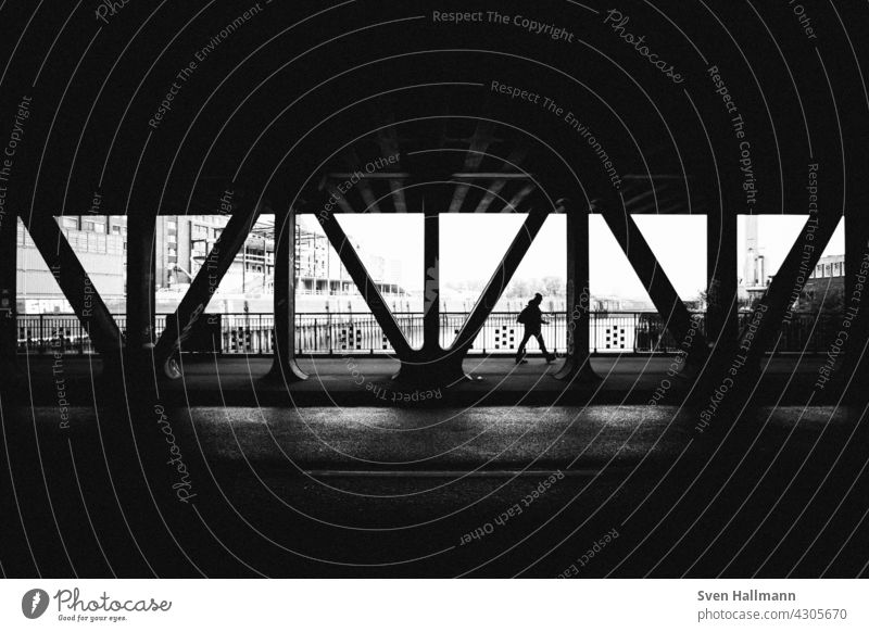 Man walking between the struts of a bridge Architecture Building Modern architecture Facade Esthetic Symmetry Design Abstract Arrangement Line