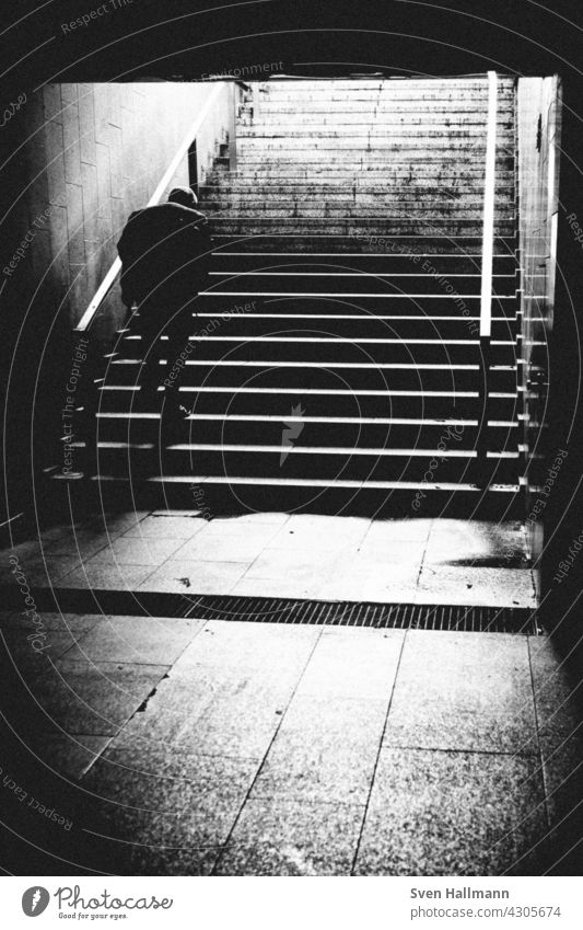 Man walking down a staircase between two imposing buildings Architecture Building Modern architecture Facade Esthetic Symmetry Design Abstract Arrangement Line