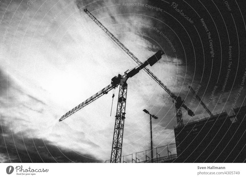 a huge building site with many cranes Crane Construction site Sky Build Tall construction sector Manmade structures slewing crane Construction crane