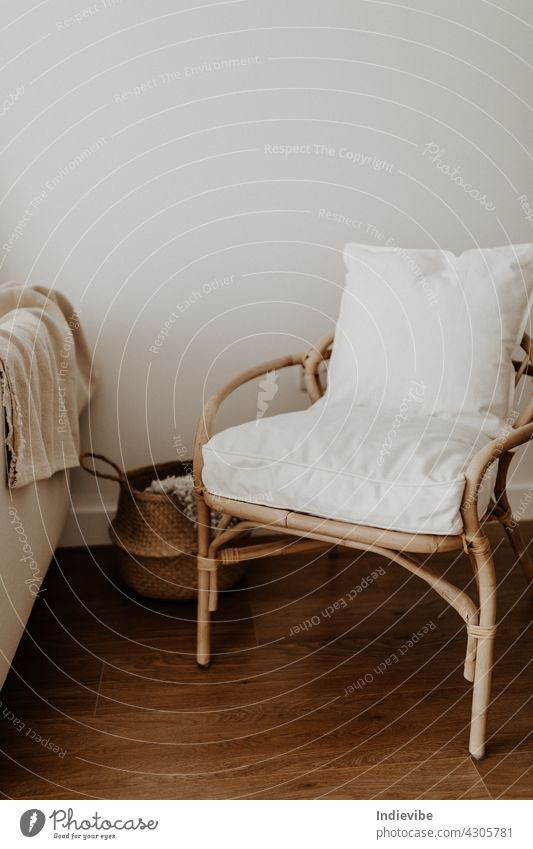 Rattan chair and basket, pillows and blanket in an empty room comfortable rattan apartment bamboo nobody beige contemporary decoration cozy cozy interior