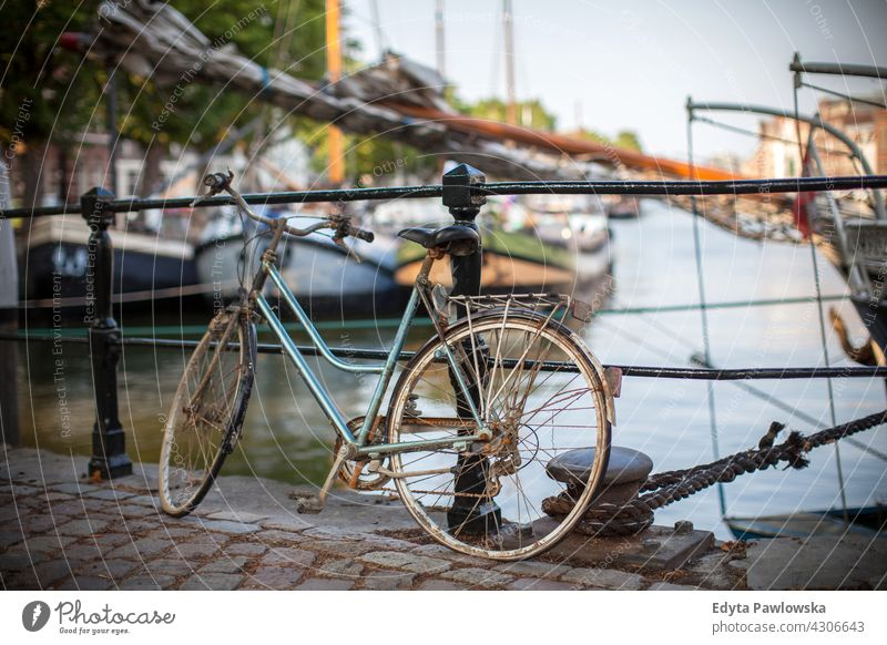 Bicycle in Dutch streets traditional old-fashioned bike bicycle cycling city Culture Europe Heritage Historic Holland Netherlands Outdoor Picturesque