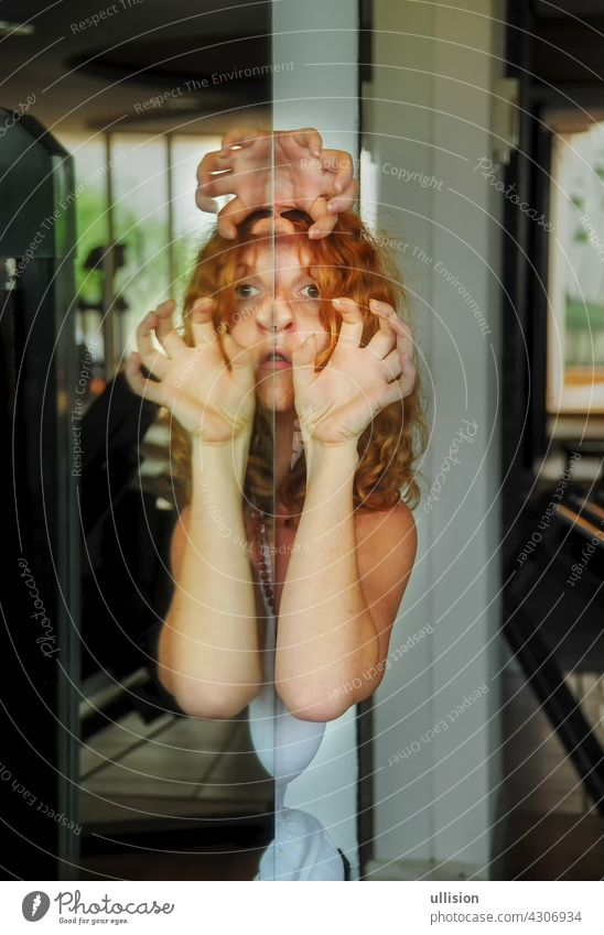 Portrait and hands of scary redhead woman, face reflection in mirror, female duality, mental disorder, subconscious crisis portrait creepy fear concept ghost