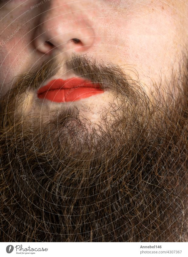 Bearded Man with Red Lipstick on His Lips , handsome pride transgender portrait lgbtq, transsexual concept lipstick beard red makeup man mouth face model