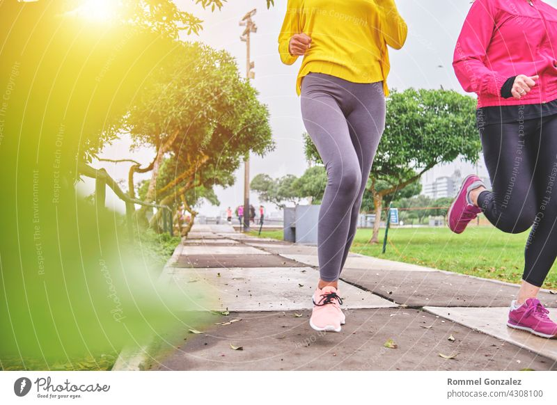 Multiethnic women jogging on the street woman city exercise fitness healthy marathon sporty energy copy space shoe training runner vitality outside speed motion