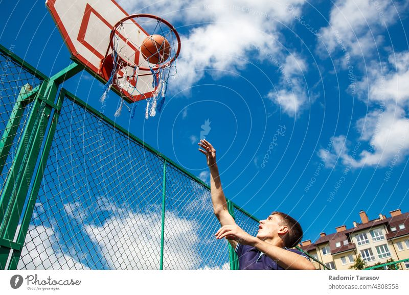 young man playing basketball player sport male athletic healthy exercise background lifestyle men action people athlete active competition white training game