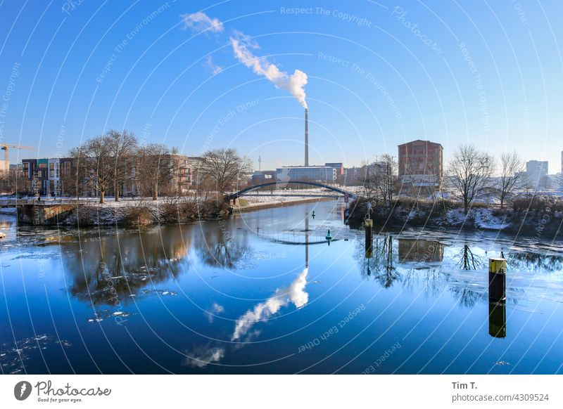 View over the north harbour to the Kiel bridge . in the background is a smokestack . Nordhafen moabit Winter Reflection Chimney Thermal power station vattenfall