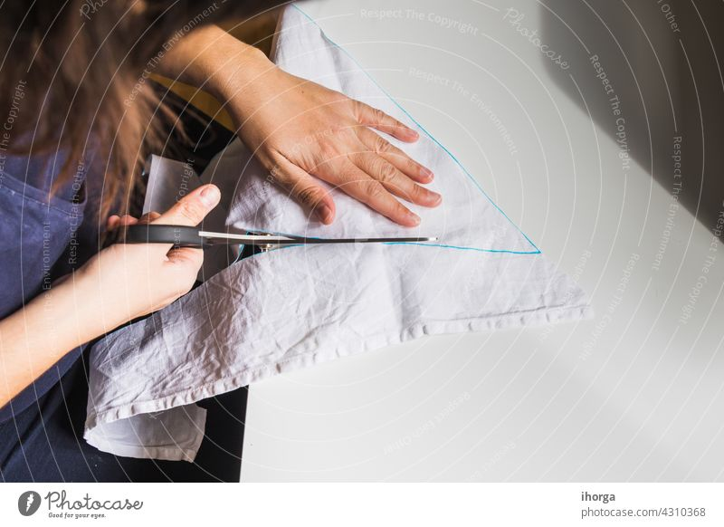 woman's hands using sewing scissors Equipment closeup cloth clothing costuming craft creative creativity design domestic dress dressmaker fabric handicraft