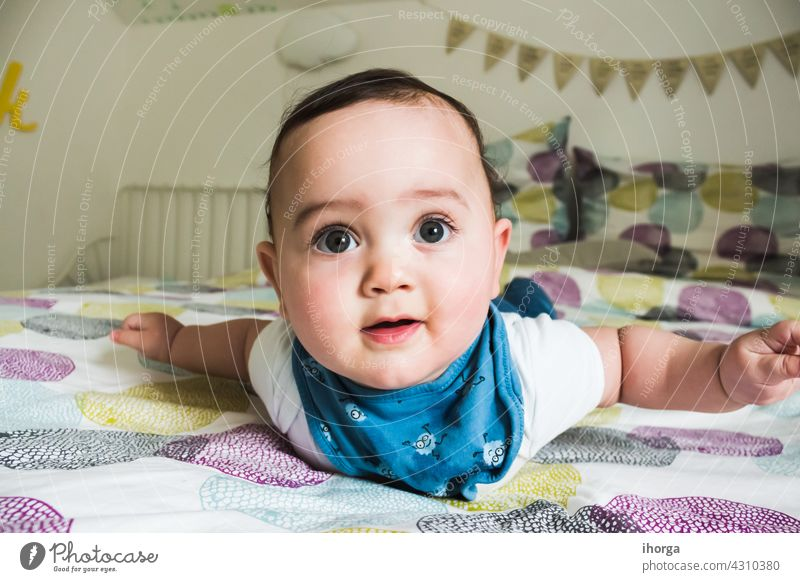 portrait of adorable baby lying babycare babyhood beautiful beauty boy caucasian child childcare childhood closeup cute emotion excitement expression eyes face