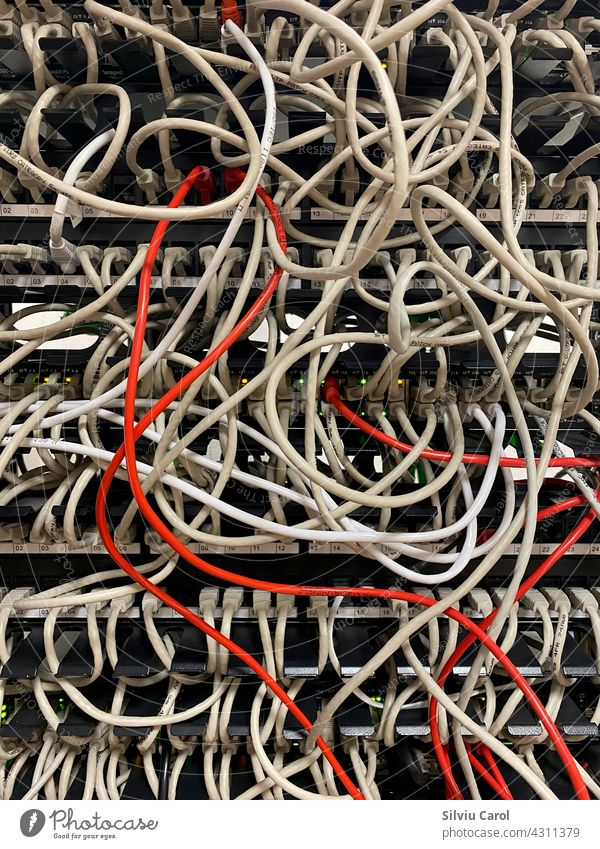 Internet cables rack not arranged on data center connection core fiber technology telecom room information digital router switch hosting industry patch