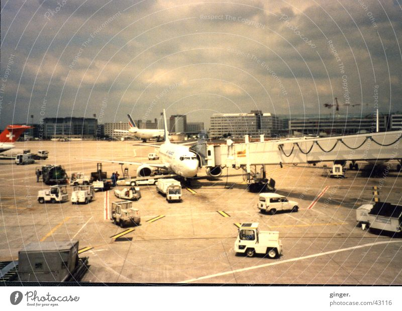 airport bustle Vacation & Travel Aviation Clouds Airport Vehicle Car Airplane Runway Driving Gray clouds Scan Gangway Colour photo